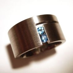 ring titanium 2.5mm round blue topaz pictured (other gems available on request) 11mm wide