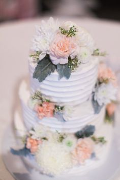 White and peach flower covered cake: http://www.stylemepretty.com/kansas-weddings/2014/10/16/romantic-manhattan-kansas-wedding-at-houston-street-ballroom/ | Photography: Keith Czechanski - http://www.keithczechanski.com/