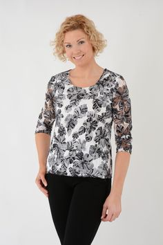 TO20141 Floral round neck lace top. This 3/4 sleeve, lined bodice, flower print top is a must have. Dress up for a special occasion in this exquisite top, our embroidered pocket trousers and heels. Length approx. 61cm. 92% Nylon 8% Elastane