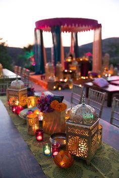 Beautiful colors: lanterns, flowers, colored glass votives.