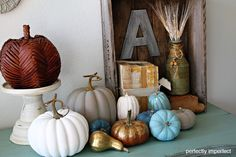 Looking for something a little different this fall? Try dressing up your pumpkins with chalk paint! Idea via perfectlyimperfectblog.com!