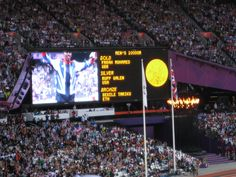 Flame seen from within the Olympic Stadium, as Mo Farah accepts his Gold Medal for the - amazing to witness Mo Farah, Believe In Miracles, Olympics, Amazing, Gold, Yellow