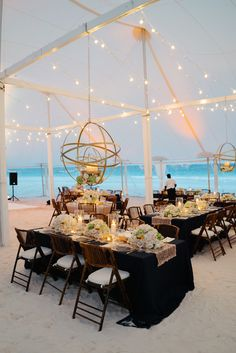 Tented Reception, Dark Tables, & String Lights   Photo: Karlisch Photography. View More:  http://www.insideweddings.com/weddings/destination-wedding-in-pink-church-on-harbour-island-in-the-bahamas/923/