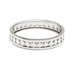 "We're smitten with the modern geometric design of the sleekly silver Imani bangle. Imani's crisp and measured look will pair perfectly with additional simple bangles and circular studs. A timeless and must-have staple!  - Silver tone metal - 2 7/10"" in diameter Item # BSH40001006"