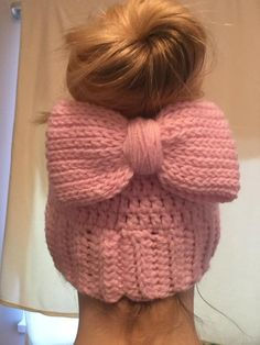 Crochet Bow Pattern: Chain 46, join and then hdc first row. Row 2-9th hdc in blo, 10th row sc. Wrap yarn around the middle and secure. You can either sew it onto your messy bun or attach it to an alligator clip.   Messy bun with bow.
