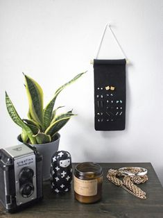 Make This: Minimal Stud Earring Organizer - - Stud earring organizer made simply from a strip of leather. Keep all your little pieces of jewelry paired up and happy. No leather working tools required! Jewellery Storage, Jewelry Organization, Jewellery Display, Jewelry Rack, Jewellery Diy, Jewelry Tree, Jewelry Holder, Closet Organization, Diamond Hoop Earrings