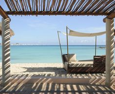 Sneak peaks of the ocean while on the cabana at, Club Med Cancun Yucatan, the Mexican all-inclusive resort in the Mexican Caribbean.