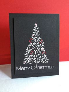 handmade Christmas card from I'm in Haven: White Christmas ... black card ... white embossed lacy tree and sentiment ... red Liquid Pearl ornaments for a splash of color ... great simple and elegant look!