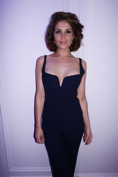 Gemma Arterton in a midnight blue Galvan jumpsuit [Photo by Stéphane Feugère]
