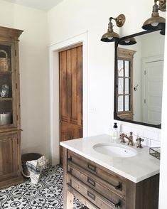 Beautiful bathroom! I love the wood with the tile floor pattern.