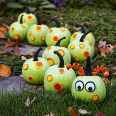 A curving line of green-painted pumpkins forms a fun caterpillar decoration.  How-to + more no-carve ideas: http://www.midwestliving.com/holidays/halloween/easy-no-carve-pumpkin-decorating/?page=6,0