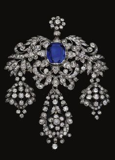 SAPPHIRE AND DIAMOND PENDANT, MID 19TH CENTURY Of girandole design, centring on cushion-sapphire in a cut down collet, decorated with scroll, floral and foliate surrounds set with fancy- and cushion-shaped, single and circular-cut diamonds, suspending three pendants similarly set, case, sapphire may be a later addition.
