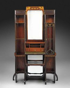 EUGENIO QUARTI (1867-1929) IMPORTANT SECRETAIRE CABINET, CIRCA 1900 walnut, mahogany, ebony, brass, pewter, mother of pearl, glass and marquetry inlay, the fall-front enclosing pigeonholes and three drawers 78 5/8 in. (199.7 cm.) high; 47½ in. (120.5 cm.) wide; 14½ in. (36.8 cm.) deep inlaid signature Quarti