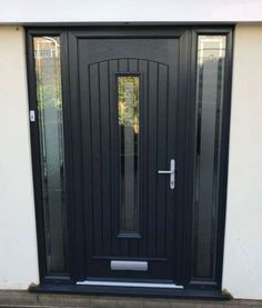 Palladio composite front entrance door in Anthracite grey with 2 full height side lights supplied and installed by Unicorn Windows Ltd, Leighton Buzzard Grey Front Doors, Front Door Entrance, Exterior Front Doors, House Front Door, Front Door Colors, Front Entrances, Entry Doors, Main Door Design, Front Door Design