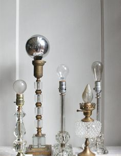 """Brilliant idea from Trampoline. Pick up some semi-ridiculous lamp bases from thrift stores, chuck the faded and outdated shades and replace with those trendy half chrome bulbs or Edison bulbs. Instant upgrade."" I must try this pronto!"