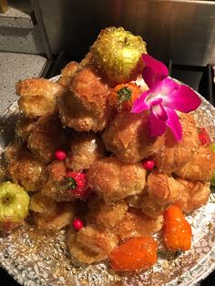 Croquembouche aka French Wedding Cake is a pyramid of cream puffs and spun sugar #wedding cake #catering DC #http://teatimeinc.blogspot.com/