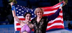 Meryl Davis and Charlie White celebrate during the ice dance flower ceremony at the Sochi 2014 Olympic Winter Games on Feb. 17, 2014 in Sochi, Russia.
