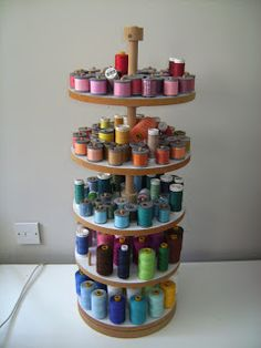 Can't decide if I want vertical thread storage like this nifty thread caddy with turning shelves. The other option is 3 custom box types designed to hold Bobbins, Thread Spools, & Serger Spools. Then I could sort by color within the box 'sets'.