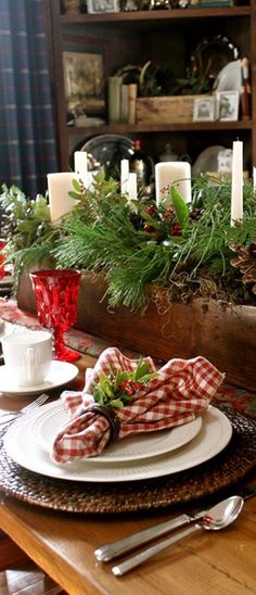Rustic Christmas Centerpiece...with candles and pine.   Canadian Log Homes.