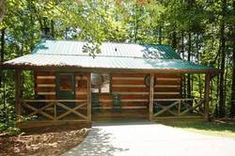 Mountain Memories - This Pigeon Forge cabin is nestled in a wooded area giving you that extra privacy you deserve.