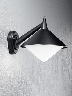 EXT6585 Sera modern Italian wall light, black aluminium. Italian die-cast aluminium matt black exterior fitting with opal polycarbonate difuser. Outdoor IP43 Rated 1 x 75w E27 Lamp not included Height- 25.5cm Width- 26.5cm Projection- 33.5cm BRAND- Franklite REFERENCE- EXT6585 AVAILABILITY: 3-4 Working Days