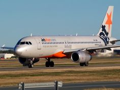 Jetstar A320 taxiing at Brisbane and looking like it needs a new paint job. Type: Airbus A320-232 Registration: VH-JQX Location: Brisbane International Airport Date: 11/07/2011