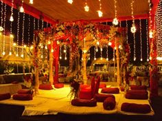 This definitely brings the festive and romantic ambience into wedding decor. Indian Wedding Receptions, Wedding Mandap, Wedding Venues, Wedding Ideas, Wedding Backdrops, Ceremony Backdrop, Wedding Ceremony, Wedding Inspiration, Indian American Weddings