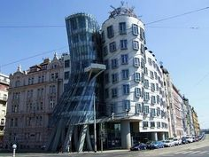 The Dancing House!  (Pragues Dancing House is one of the most famous buildings in Europe. It was designed by Czech architect Vlado Milunic in co-operation with Canadian architect Frank O. Gehry. The building Commissioned by the Dutch Bank ING, was constructed between 1992-1996 in deconstructivist style. It resembles two dancers, with the glass construction in the shape of a women wearing a skirt. This is why the building is also being called Fred and Ginger!)