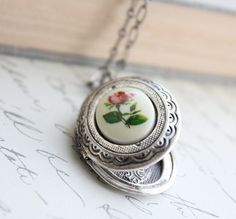 Hey, I found this really awesome Etsy listing at http://www.etsy.com/listing/112743645/silver-locket-necklace-red-rose-cameo