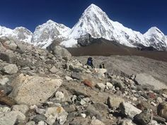 #Everest_Base_Camp_Trekking : OUr trekkers are walking near by gorek shep where amazing Mt. Pumori with khumbu glacier on the picture & beautiful pray flags on the top of .To experience the real adventure Do Book now for grab these moment with us in Nepal. #EBC_trek #khumbu_sagarmatha #Glacier_icefall #Mt_Everest #World_highest #Himalayas_sherpa #hiking_trail #trekking_tours #LAkes_glaciers #Kalapathar_Namche_Lukla : @Clear_Sky_Treks....