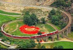 The Brusio spiral viaduct is a single track nine-arched stone spiral railway viaduct located in Brusio, in the Canton of Graubünden, Switzer. Bernina Express, Train Tickets, Model Train Layouts, Lake Como, Natural Wonders, Tour Guide, Switzerland, Beautiful Places, Amazing Places