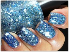 Smurf Dance LE - a clear base with blue and white bars, various sizes of blue and white hexes & fine holo glitter, a coat over China Glaze Man Hunt - a bright blue creme
