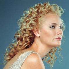 Consider a curly wedding hairstyle for the mother of the bride or mother of the groom.