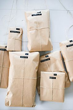 I love simple wrapping and usually use butcher paper or shipping paper and a little natural twine or baker's string as a tie. I love the added touch here of using a label maker to create a simple name tag. Gonna borrow this idea for sure!