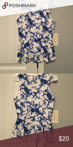 XXI White and Blue China Pattern Peplum Top XXI White and Blue China Pattern Peplum Top. Great for any occasion, with pencil skirts, jeans, black pants, blazers! Worn twice, excellent condition! Forever 21 Tops Blouses