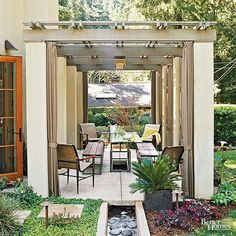 This contemporary pergola demonstrates how the right design for an outdoor structure can add real living space to a home. Repetition of the stucco and trim exterior makes for a smooth transition from indoors to out, while decorative landscaping around the base of the pergola adds visual interest.