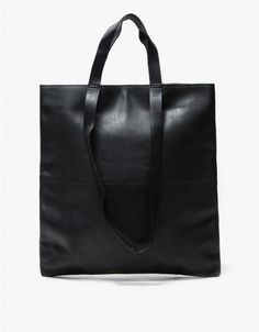 From Just Female, a timeless, simple tote in Black. Exterior center seam detail. Top handles and shoulder straps. Hidden snap-button closure. Roomy main compartment. Interior zip pocket. Clean design. Lined.  • Leather shell, sateen lining • 100% leath