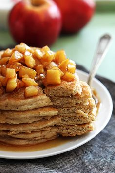Apple Cinnamon Pancakes - Fluffy cinnamon pancakes with ooey gooey apple topping! Click through for recipe!