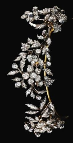 DIAMOND TIARA, LATE 19TH CENTURY Designed as three floral sprays, set with cushion-shaped, circular-cut and rose diamonds, inner circumference approximately 226mm, each spray detachable and may be worn as a brooch, fitted case. by tabitha
