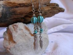 Turquoise and Silver Feather Dangle Earrings by FaeMoonWolfDesigns, $22.00