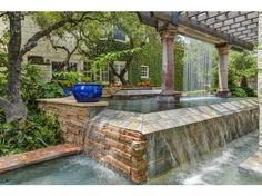 Outdoor living like no other! Magnificent back yard with pool, spa, sport court and kitchen - your own personal oasis! As you enter the cul-de-sace to your private property you are welcomed by a beautiful 2-story stone home with 2nd story balcony surrounded by lush trees as well as gorgeous water feature in prestigious guard gated community. Warm & inviting interior with scored concrete floors. #zillow