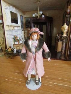 Catriona Hall, IGMA fellow – porcelain woman with hand sewn, removable clothes