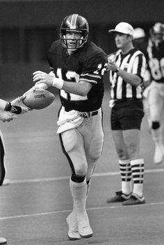 Quarterback Jim Kelly helped popularize the run-and-shoot offense when he played for the USFL's Houston Gamblers in 1984 and 1985. The team played its home games in the Astrodome during the winter and spring. Kelly went on to have a Hall of Fame career with the Buffalo Bills beginning in 1986. (Richard J. Carson/AP)
