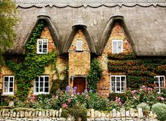 This cottage belongs in one of the British tv series that are set in gorgeous country villages.
