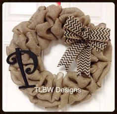Cute burlap wreath with chevron bow and your choice of medium monogram!    Perfect for the holiday season and year round!!    This wreath can be