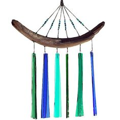 Handmade Fused Glass Windchime: Blues & Greens. Inspired by the beauty of the sea, the WindSpirit chime is individually created using kiln-fired glass panels in shades of blue and green. Secured with durable nylon cording, the glass dangles from natural beach-gathered driftwood. Unlike metal versions, the glass panels create a light, tranquil harmony of chimes in the wind and catch the sunshine with a gorgeous color combination. This chime will add a colorful touch to any indoor or outdoor…