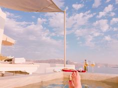 Welcome to Alta Mare by Andronis, one of the best luxury Oia Santorini hotels perched on the edge of the Caldera's dramatic cliff that disarms your senses. Greek Islands, Santorini, Greece, Villa, Patio, Luxury, Architecture, Outdoor Decor, Greek Isles