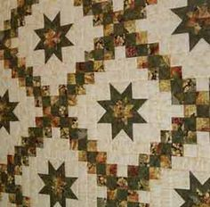 Star in Double Irish Chain Quilt.  Link is to a very expensive kit or finished product for sale, but it should be easy enough to recreate... it's almost completely squares with just a few half square triangles thrown in.