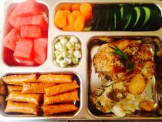 PlanetBox work lunch day 14: left over garlic chicken, pretzel thins (hollow rods. 69 cal),watermelon, cucumber, carrots, wasabi peas