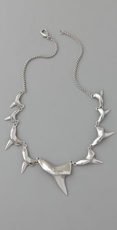 My goodness. I'm not really into shark teeth jewelry, but this is gorgeous and I'm kind of in love with it.